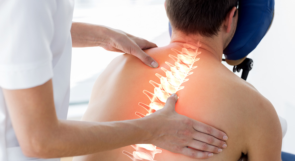 Chiropractor adjusting patient with illuminated spine